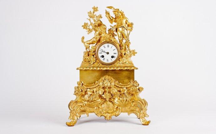 каминные часы - неспешное течение времени