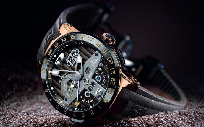 Обои Красивые мужские наручные часы в песке, обои для рабочего
